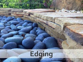 Flagstone edging with mexican beach pebbles.
